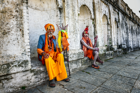 ascetic: KATHMANDU, NEPAL - OCTOBER 21, 2015 : Wandering  Shaiva sadhus (holy men) with traditional body painting in ancient Pashupatinath Temple