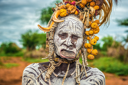 ethiopian ethnicity: OMO VALLEY, ETHIOPIA - MAY 7, 2015 : Old woman from the african tribe Mursi with lip plate in her village.