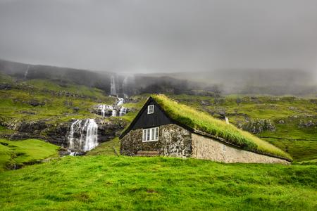 scenery: Historic stone house with turf roof on the island of Streymoy, Saksun, Faroe Islands