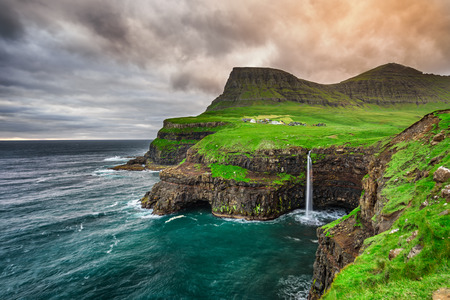 Gasadalur village and its iconic waterfall, Vagar, Faroe Islands, Denmark 스톡 콘텐츠