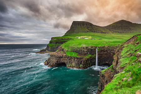 waterfalls waterfall: Gasadalur village and its iconic waterfall, Vagar, Faroe Islands, Denmark Stock Photo