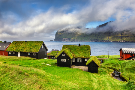 roof: Village of Mikladalur located on the island of Kalsoy, Faroe Islands, Denmark Stock Photo