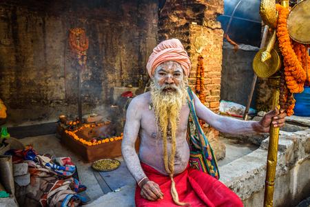 long beard: KATHMANDU, NEPAL - OCTOBER 21, 2015 : Portrait of Shaiva sadhu (holy man) with traditional long beard in Pashupatinath Temple