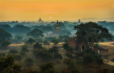 history background: Scenic sunrise above Bagan in Myanmar. Bagan is an ancient city with thousands of historic buddhist temples and stupas.