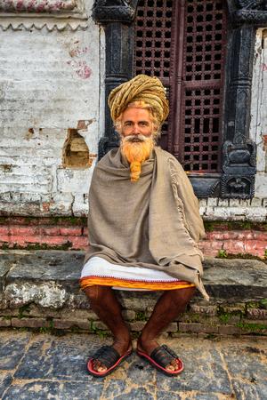 sadhu: KATHMANDU, NEPAL - OCTOBER 21, 2015 : Wandering  sadhu baba (holy man) with traditional long hair in ancient Pashupatinath Temple