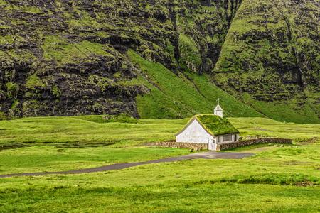 Small village church in Saksun on the island of Streymoy, Faroe Islands, Denmark 스톡 콘텐츠