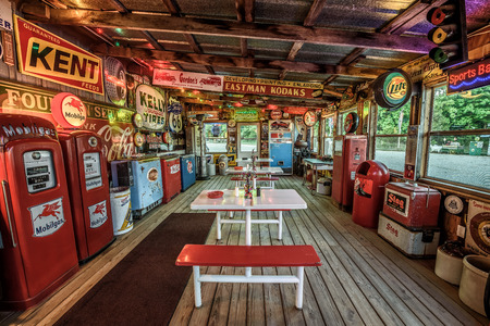 old service station: CUBA, MISSOURI, USA - MAY 11, 2016 : Interior of Bobs Gasoline Alley on historic Route 66 in Cuba. It is is a collection of over 300 service station signs and other vintage advertisements. Editorial