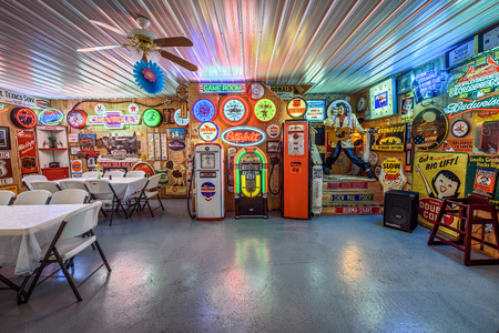 old service station: CUBA, MISSOURI, USA - MAY 11, 2016 : Interior of Bobs Gasoline Alley on historic Route 66. It is is a collection of over 300 service station signs and other vintage advertisements. HDR processed. Editorial