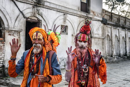 KATHMANDU, NEPAL - OCTOBER 21, 2015 : Wandering  Shaiva sadhus (holy men) with traditional body painting in ancient Pashupatinath Temple