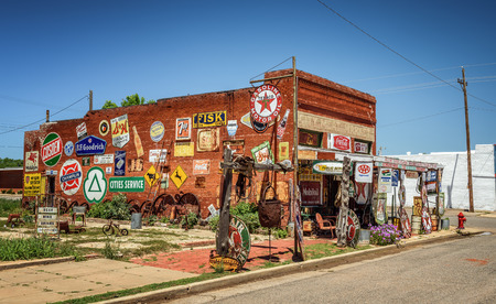 old service station: ERICK, OKLAHOMA, USA - MAY 12, 2016 : Sandhills Curiosity Shop located in Ericks oldest building - the City Meat Market. It is a large collection of crazy Route 66 memorabilia. Editorial