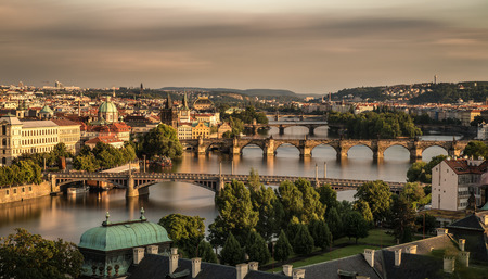 bohemia: Historic bridges of Prague at the golden hour photographed from Letna park. Long exposure.