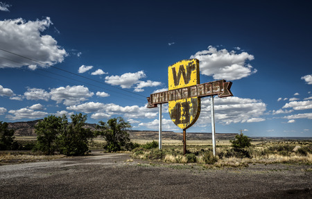 mountings: SAN FIDEL, NEW MEXICO, USA - MAY 13, 2016 : Vintage Whiting Bros. sign above a removed gas station on historic Route 66 in New Mexico.