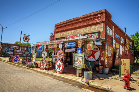 memorabilia: ERICK, OKLAHOMA, USA - MAY 12, 2016 : Sandhills Curiosity Shop located in Ericks oldest building - the City Meat Market. It is a large collection of crazy Route 66 memorabilia. Editorial
