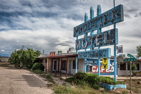 frontier: TRUXTON, ARIZONA, USA - MAY 18, 2016 : Abandoned Frontier Motel, Cafe and vintage neon sign on historic Route 66 in Mohave County, Arizona