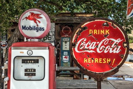 HACKBERRY, ARIZONA, USA - MAY 19, 2016 : Retro gas pump and a rusty coca-cola sign  on historic Route 66 in Arizona