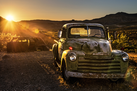 COOL SPRINGS, ARIZONA, USA - MAY 19, 2016: Summer sunset above car wrecks in the Mojave desert on historic route 66. Hdr processed.