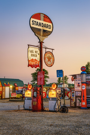 old service station: CUBA, MISSOURI, USA - MAY 11, 2016 : Bobs Gasoline Alley on historic Route 66 in Cuba. It is is an outdoor and indoor collection of over 300 service station signs and other vintage advertisements.
