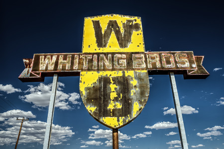 abandoned gas station: SAN FIDEL, NEW MEXICO, USA - MAY 13, 2016 : Vintage Whiting Bros. sign on historic Route 66 in New Mexico.
