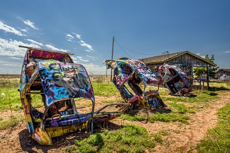 CONWAY, TEXAS, USA - MAY 12, 2016 : Bugg Ranch on Route 66. Bugg Ranch is a public  art installation of old VW Slug car wrecks and a popular landmark on historic Route 66
