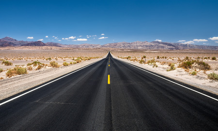 Long empty road running through Panamint Valley in Death Valley National Park, California 스톡 콘텐츠