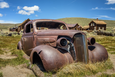 Car wreck in Bodie ghost town, California. Bodie is a historic state park from a gold rush era  in the Bodie Hills east of the Sierra Nevada Stock Photo
