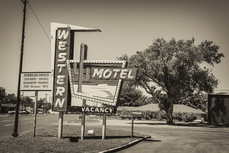 western usa: SAYRE, OKLAHOMA, USA - MAY 12, 2016 : Western Motel and vintage neon sign on historic Route 66 in Oklahoma. Editorial