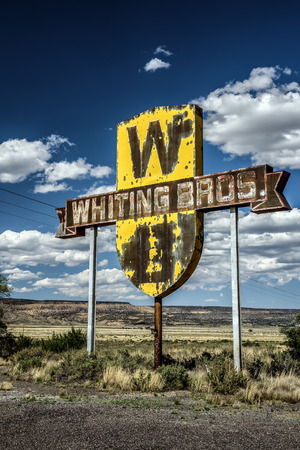 bros: SAN FIDEL, NEW MEXICO, USA - MAY 13, 2016 : Vintage Whiting Bros. sign above a removed gas station on historic Route 66 in New Mexico.