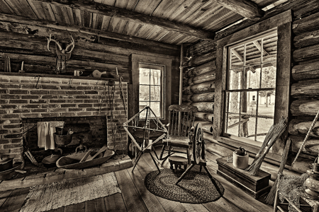 LARGO, FLORIDA - JANUARY 14, 2015 : Interior of the historic McMullen-Coachman Log House in the Pinellas County Heritage Village. It is a typical Florida Cracker log home of the pioneer period.