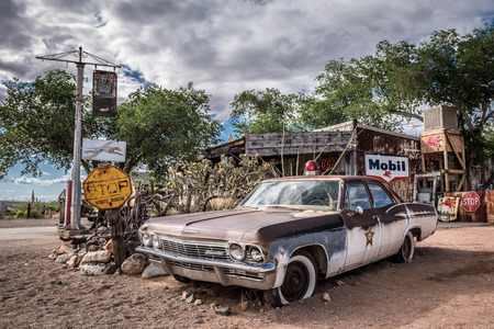 HACKBERRY, ARIZONA, USA - MAY 19, 2016 : Old sheriffs car wreck with a siren left abandoned near the Hackberry General Store. Hackberry General Store is a famous stop on the historic Route 66. Editorial