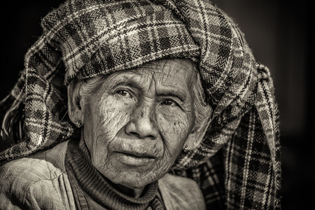 PINDAYA, MYANMAR - JANUARY 25, 2016 : Black and white portrait of an old indigenous woman in Myanmar Sajtókép