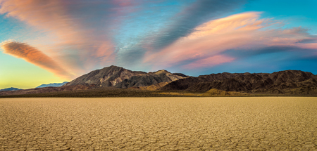 Scenic sunset at Racetrack Playa  in Death Valley National Park. The Racetrack Playa is a scenic dry lake with moving stones that inscribe linear imprints.
