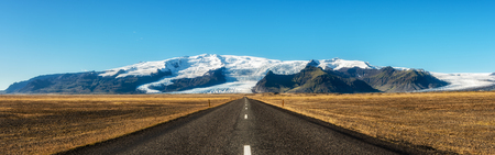 pano: Famous ring road in Iceland leading to Vatnajokull, also known as the Vatna Glacier. It is the largest ice cap in Iceland. Stock Photo