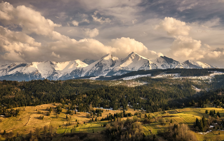 snowy field: Spring comes to the snowy high tatra mountains. High Tatras is a  mountain range along the border of northern Slovakia and southern Poland.