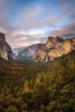 bridalveil fall: Yosemite Valley and Bridalveil Fall at sunset from tunnel view, California. Long exposure. Stock Photo