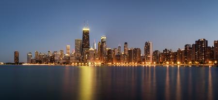 Chicago skyline panorama across Lake Michigan at night viewed from North Avenue Beach. Long exposure.