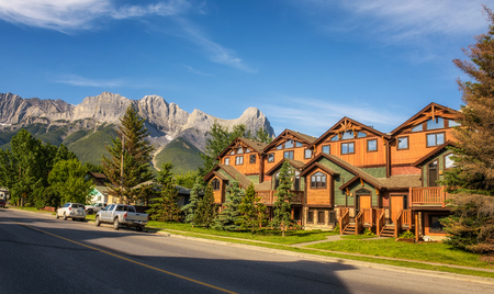 canmore: CANMORE, ALBERTA, CANADA - JUNE 26, 2017 : On the streets of Canmore in canadian Rocky Mountains. Canmore is located in the Bow Valley near Banff National Park and is a popular tourist destination.