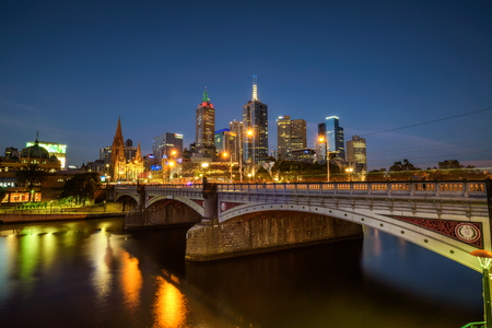princes street: City skyline of Melbourne downtown, Princess Bridge and Yarra River at night. Long exposure. Stock Photo