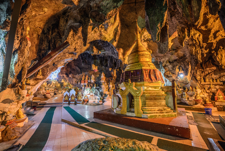 PINDAYA, MYANMAR - JANUARY 25, 2016 : Buddha statues inside the  Shwe Umin Pagoda Paya,  Myanmar (Burma).  Pindaya Caves  are a famous Buddhist pilgrimage site and a tourist attraction. HDR processed.