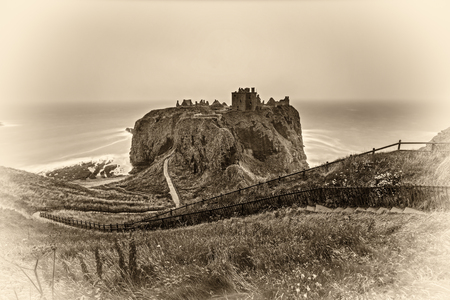 Dunnottar Castle, Scotland, United Kingdom. Vintage black and white processed. Editorial