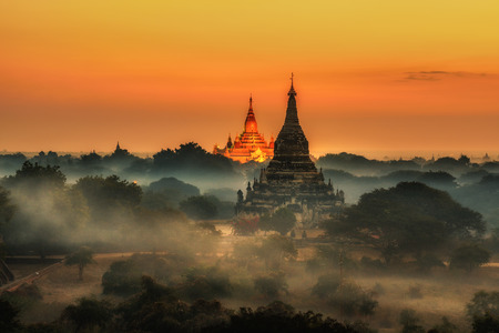 Scenic sunrise above Bagan in Myanmar. Bagan is an ancient city with thousands of historic buddhist temples and stupas.