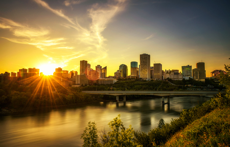 Sunset above Edmonton downtown, James Macdonald Bridge and the Saskatchewan River, Alberta, Canada. Long exposure. Reklamní fotografie