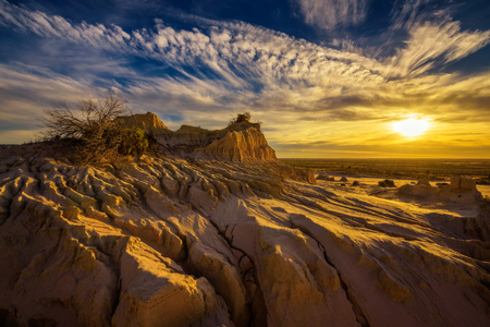 Dramatic sunset over Walls of China in Mungo National Park, New South Wales, Australia Stock Photo
