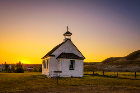 Summer sunset over the old wooden pioneer church in the ghost town of Dorothy in Alberta, Canada. Stock Photo