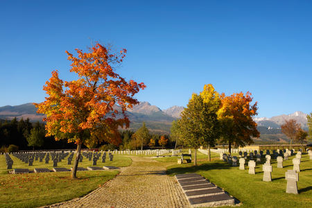 German military cemetery in autumn with High Tatras mountains in the background