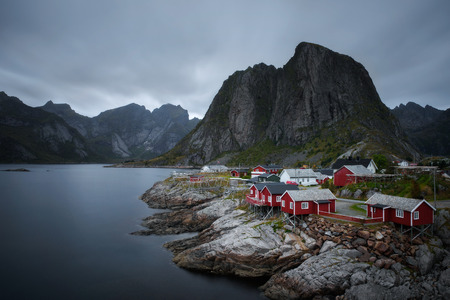 Traditional red rorbu cottages in Hamnoy village, Lofoten islands, Norway Stock Photo