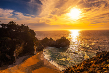 Sunset over McWay Falls on Pacific Coast Highway in California Stock Photo