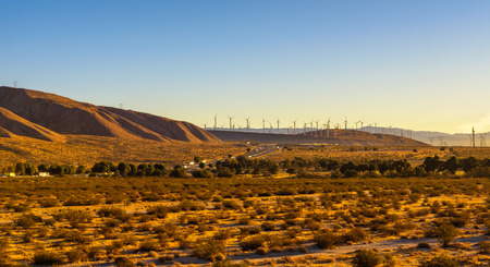 Windmills along a highway in Mojave desert, California