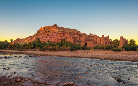Ait Benhaddou with Asif Ounila river in Morocco at sunset
