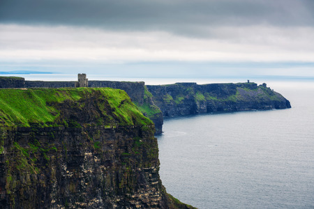 Stone observation tower at Cliffs of Moher in Ireland Standard-Bild - 127115195
