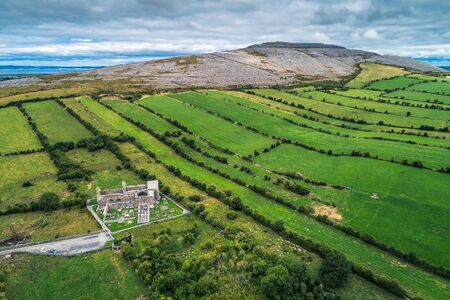 Aerial view of Corcomroe Abbey ruins and its cemetery Standard-Bild - 127115077